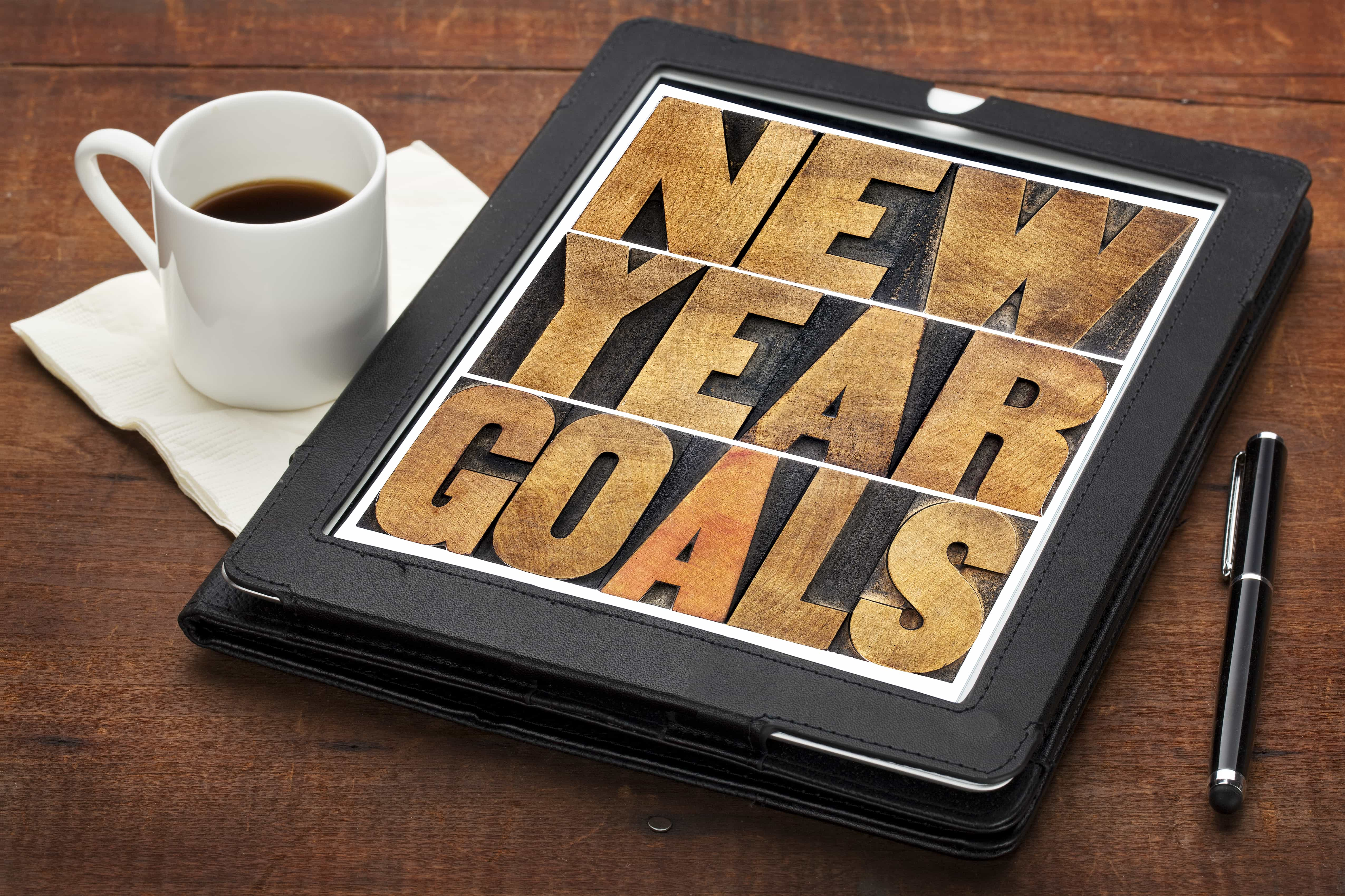 New Year goals - resolutions concept - text in vintage letterpress wood type on a digital tablet screen