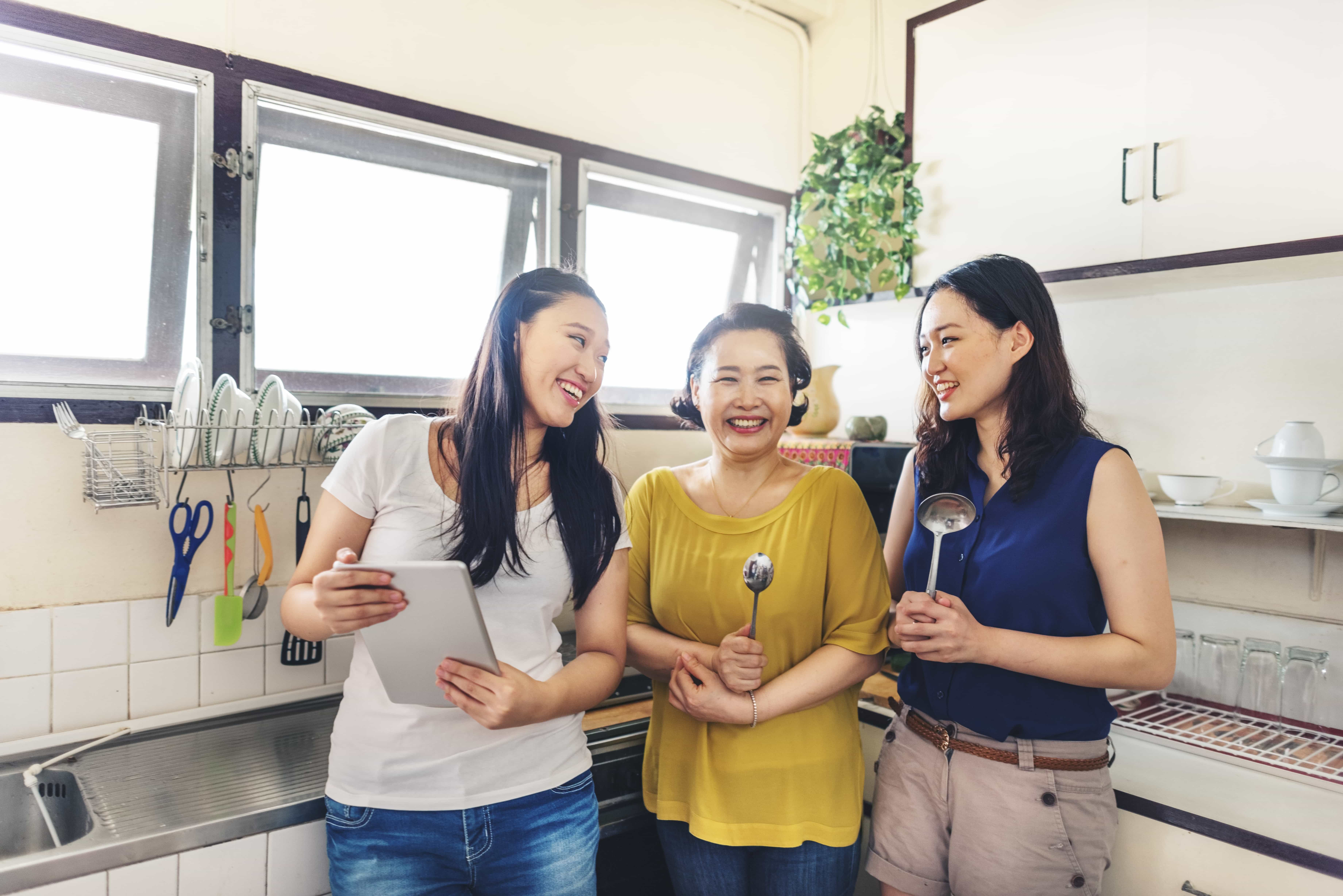 Family of asian women in the kitchen free image