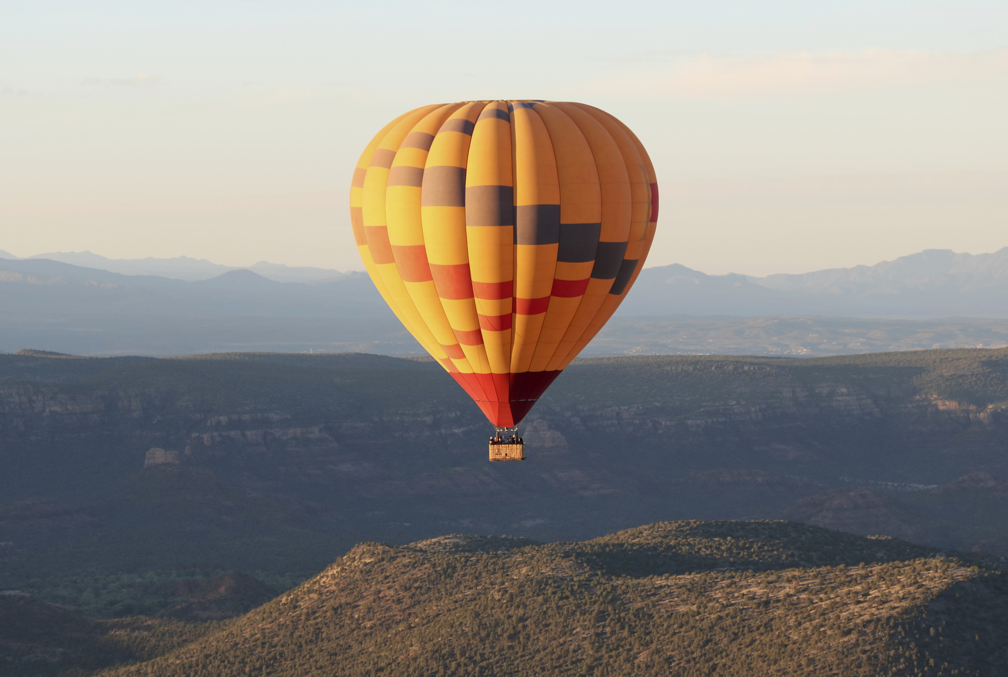 A Hot Air Balloon Soars Above Coconino National Forest, Sedona, Arizona